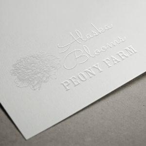 Alaska Blooms Embossed Paper Logo MockUp
